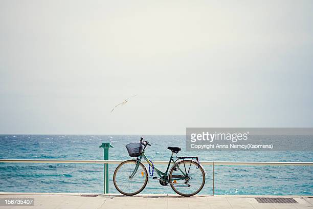 Bicycle on the sea promenade over blue sky