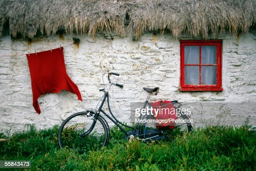 Bicycle outside a cottage, Cregnesh, Isle of Man, British Isles