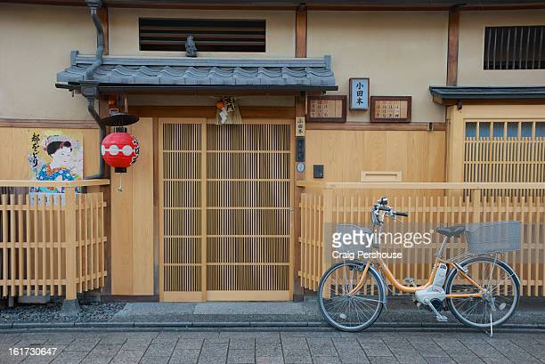 Bicycle outside traditional wooden tea house