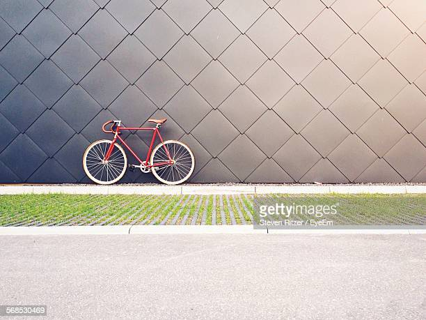 Bicycle Parked Against Patterned Wall