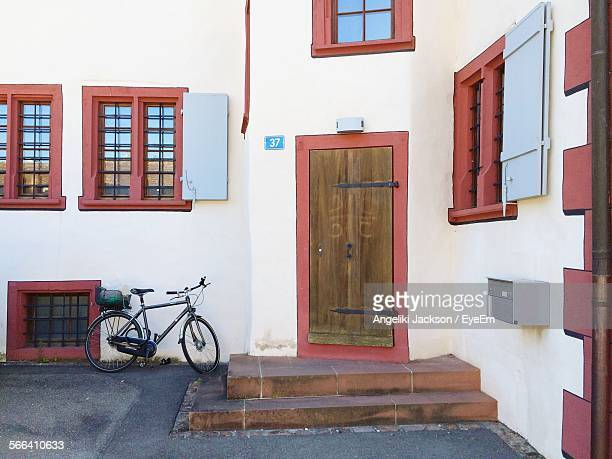 Bicycle Parked By Door Of House