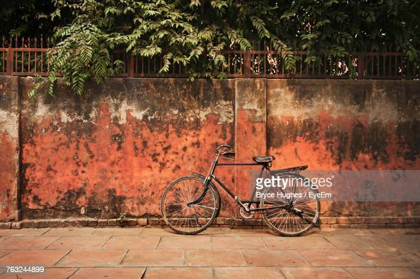 Bicycle Parked By Wall