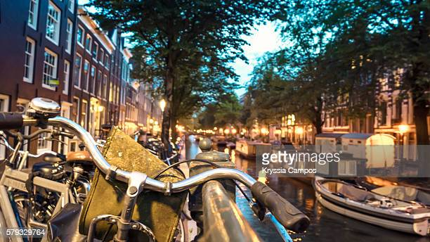 Bicycle parked on bridge over a canal, Amsterdam
