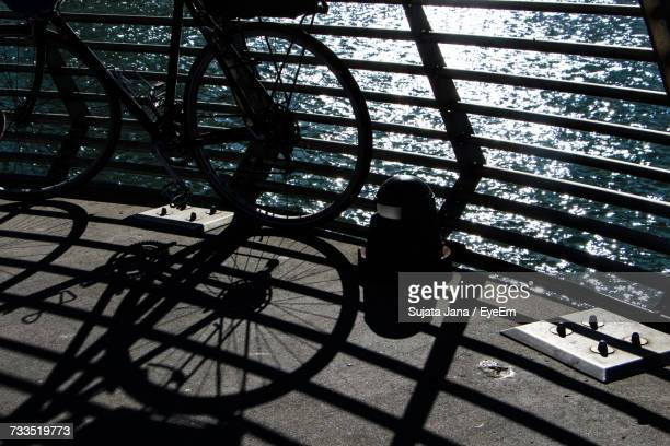 Bicycle Parked On Bridge Over Sea