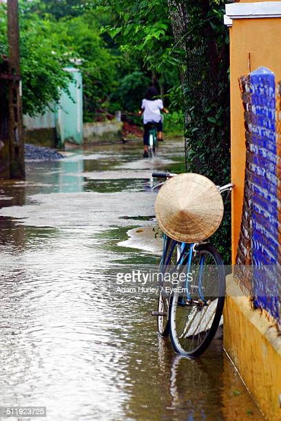 Bicycle parked on flooded street