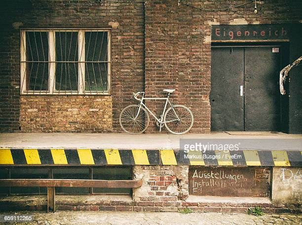 Bicycle Parked On Footpath By Old Building