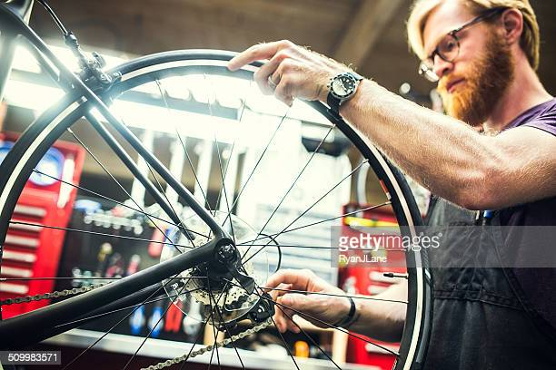 Bicycle Repair Shop and Man Working