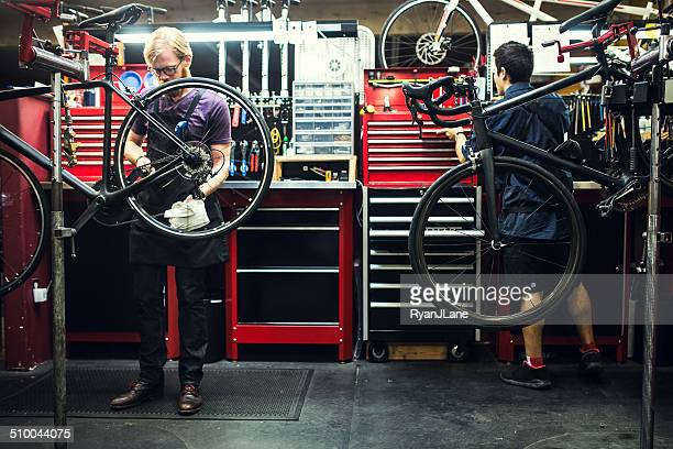 Bicycle Repair Shop and Men Working