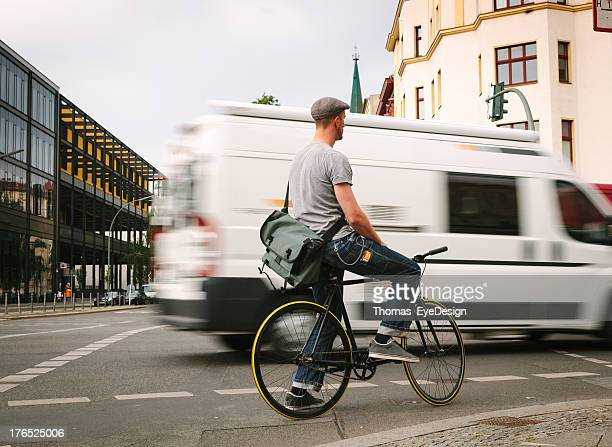 Bicycle Rider in City Traffic