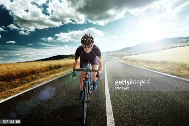 Bicycle Rider pedaling on a Country Highway
