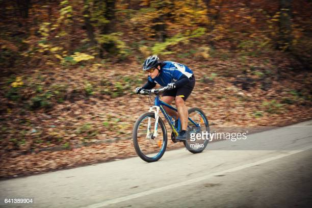 Bicycle riding downhill on the road