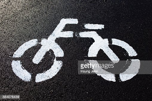 Bicycle riding sign on road
