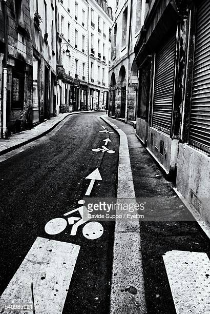 Bicycle Road Sign On Street Amidst Buildings