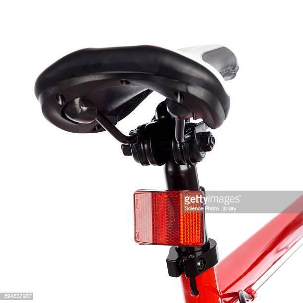 Bicycle saddle and reflector
