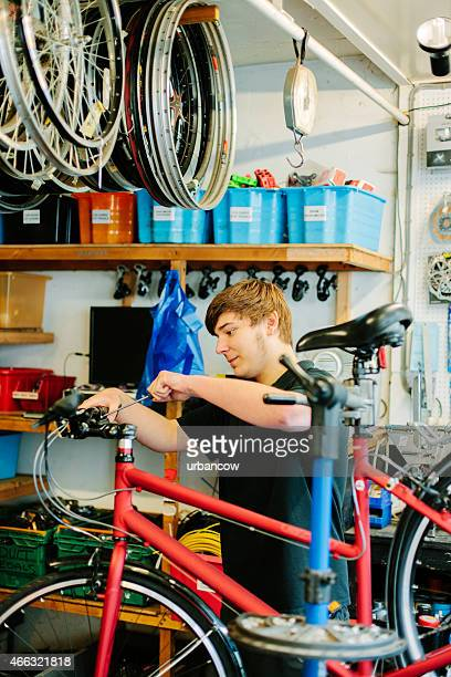 Bicycle shop, offering servicing and maintenance. One person