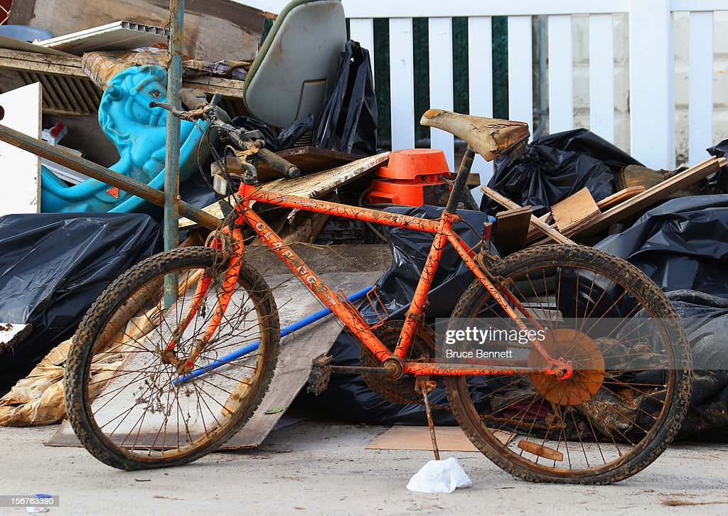 A bicycle showing the effects of high tide is left out for removal on November 20, 2012 in Long Beach, New York. More than three weeks after Superstorm Sandy hit the New York area, residents continue their restoration efforts in many affected areas on Long Island.