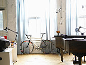 Bicycle stands besides window