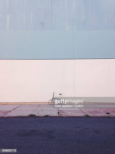 Bicycle Under Wall