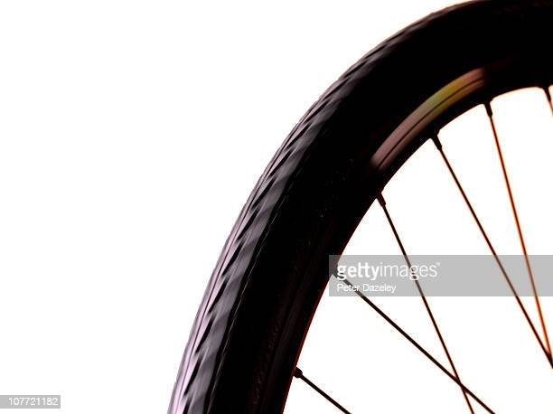 Bicycle wheel on white with copy space