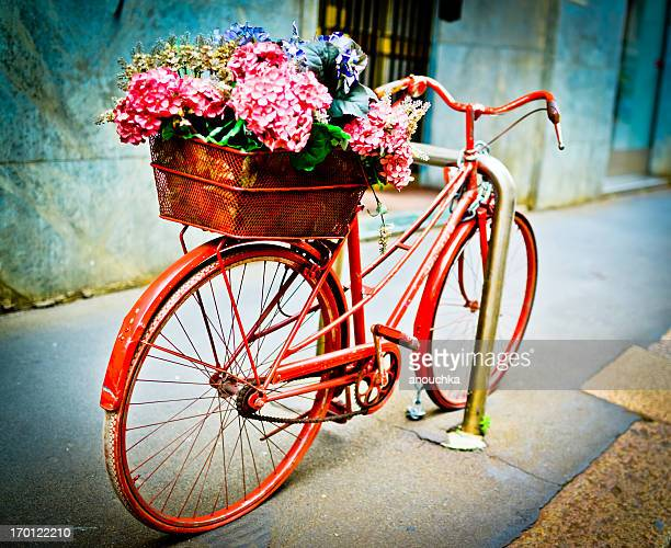 Bicycle with flowers parked on Milan street, Italy