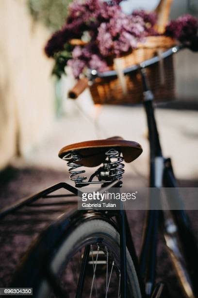 Bicycle with with fresh bread and flowers