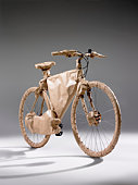 Bicycle wrapped in brown paper