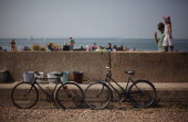 Bicycles and buckets are displayed for sale on a flood defence wall on August 3 2011 in Whitstable England Parts of southern England are experiencing...