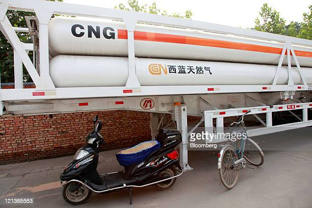 Bicycles are parked near gas canisters at a China Natural Gas Inc filler station in Xi'an Shaanxi Province China on Thursday Aug 11 2011 China...