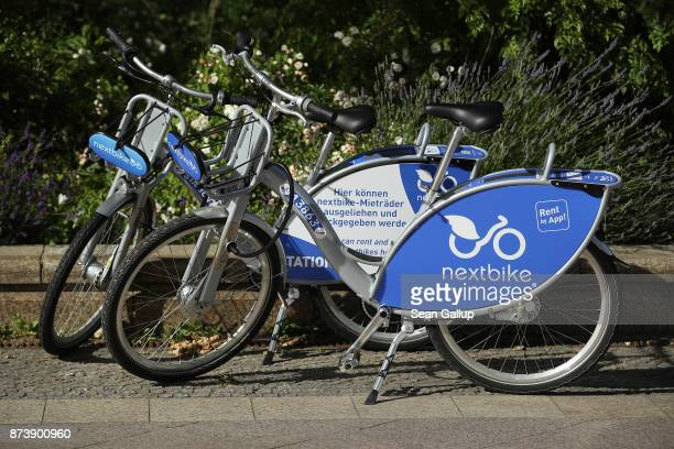 Bicycles available for rent through the Nextbike app stand in the city center on June 21 2017 in Berlin Germany A number of companies have plunged...
