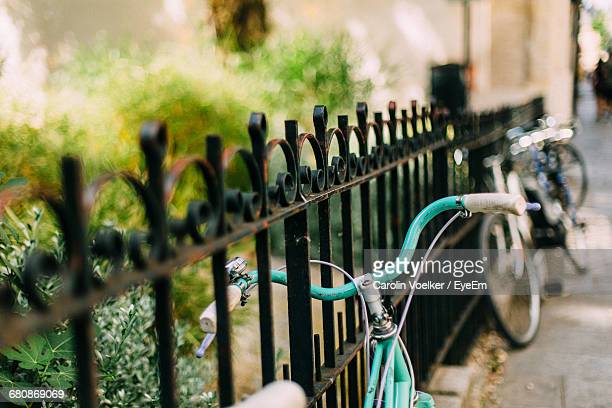 Bicycles By Fence