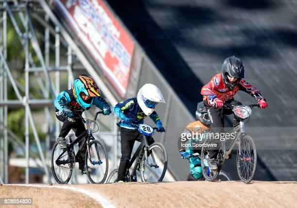 Bicycles' Cory Lebaron leads other 8 Experts through the first jump at the USA BMX Mile High Nationals on August 6 at Grand Valley BMX in Grand...