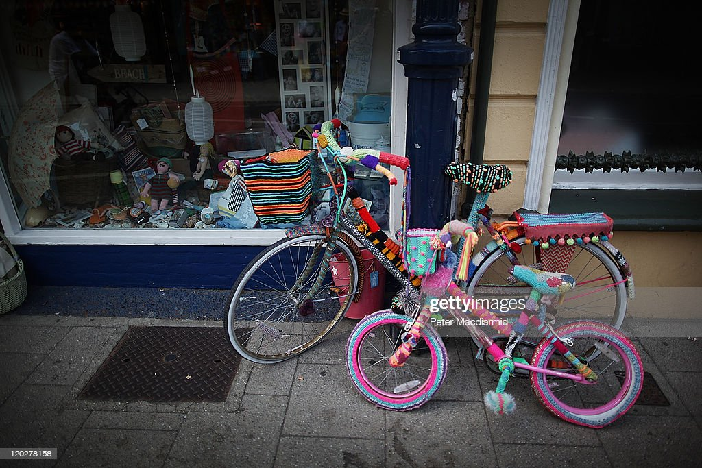 Bicycles covered with knitted decoration sit outside a shop on August 3, 2011 in Whitstable, England. Parts of southern England are experiencing high summer temperatures.