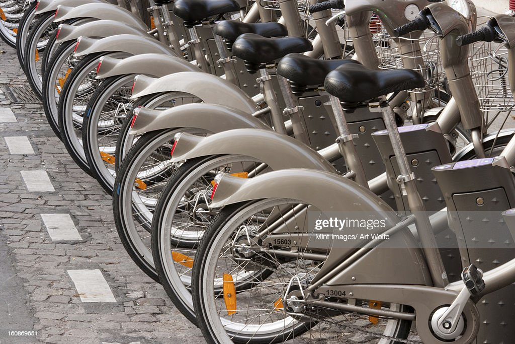 Bicycles for rent, Paris, France : Stock Photo