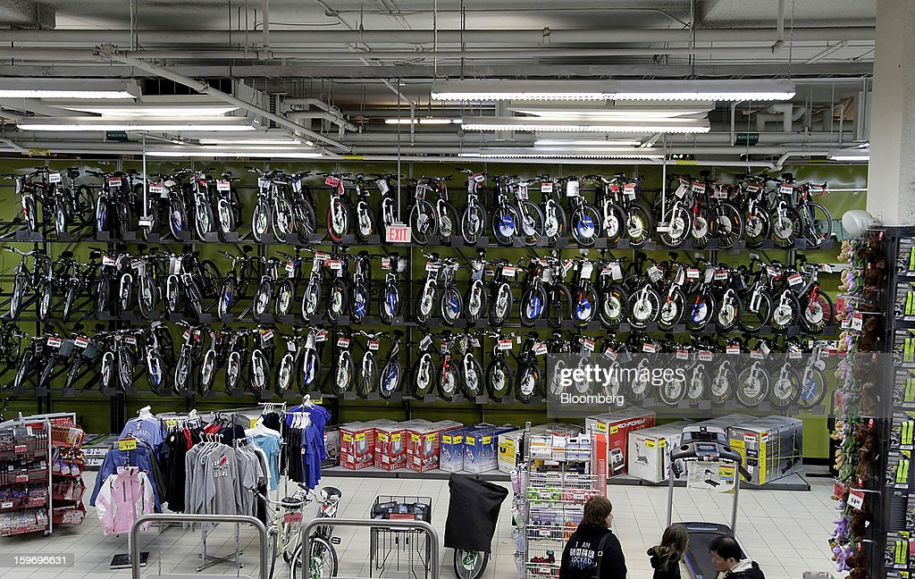 Bicycles hang on display for sale at a Canadian Tire Corp. store in Toronto, Ontario, Canada, on Friday, Jan. 18, 2013. STCA - Statistics Canada is scheduled to release retail sales data on Jan. 21. Photographer: Reynard Li/Bloomberg via Getty Images
