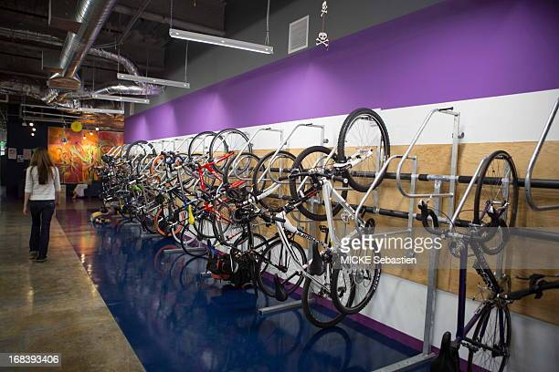 Bicycles hang on the wall in one of the many open work spaces at the Facebook office on April 23 2013 in Menlo Park United States