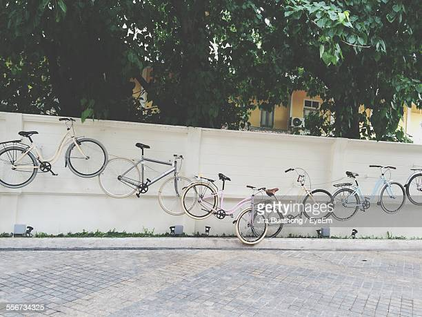 Bicycles Hanging On Wall