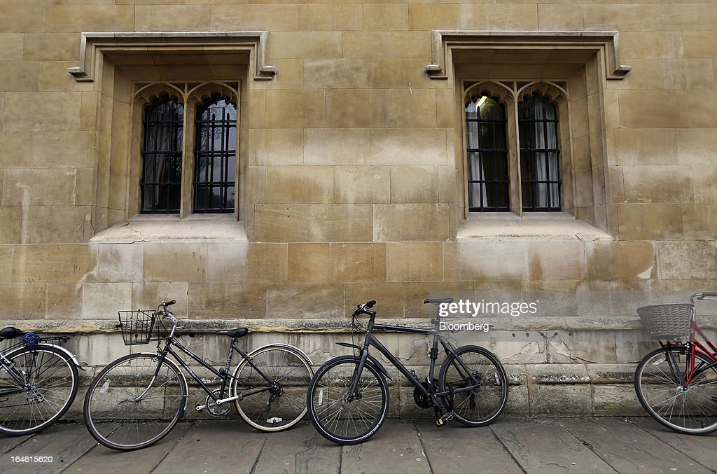 Bicycles lean on a wall outside Corpus Christi College, part of the University of Cambridge, in Cambridge, U.K., on Friday, March 22, 2013. In 2011, the U.K.'s government unveiled a plan to reduce state spending on higher education and shift more of the costs to students through tuition increases and a loan program. Photographer: Chris Ratcliffe/Bloomberg via Getty Images