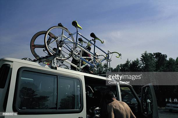 Bicycles on a van Two bicycles tied to the luggage rack of a van in the Casa de Campo Park in Madrid