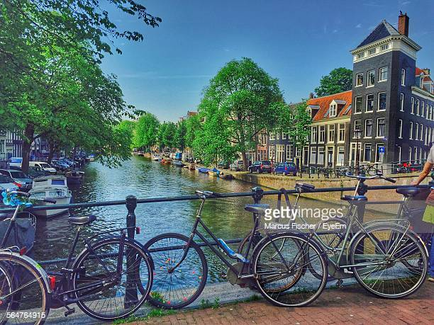 Bicycles Parked Against Canal