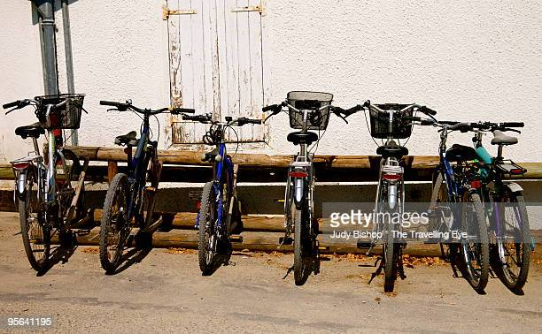 Bicycles parked, awaiting the riders