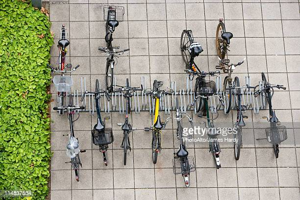 Bicycles parked in bicycle rack, overhead view