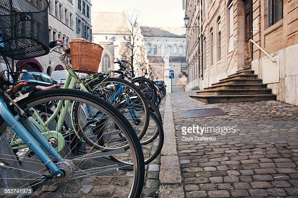 Bicycles parked on cobbled streets of Geneva