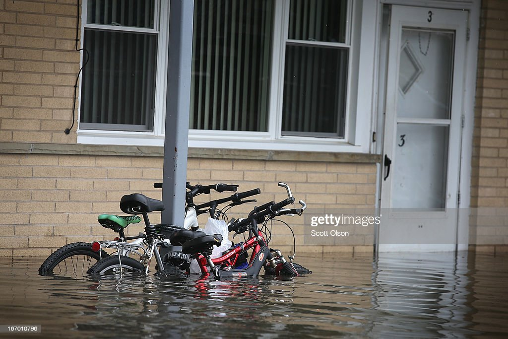 Bicycles sit in floodwater outside an apartment building April 19, 2013 in Des Plaines, Illinois. The suburban Chicago town is battling floodwater from the Des Plaines River which is expected to crest at a record 11 feet later today. Record-setting rains and rising rivers have caused wide-spread flooding in many Illinois communities.