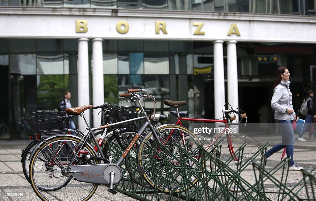 Bicycles stand on a bike rack outside the headquarters of the Ljubljanska borza d.d. (LJSE), also known as the Ljubljana stock exchange in Ljubljana, Slovenia, on Monday, May 6, 2013. Slovenia plans to increase taxes to make up for the swelling budget shortfall as the country works to recapitalize its banks. Photographer: Chris Ratcliffe/Bloomberg via Getty Images