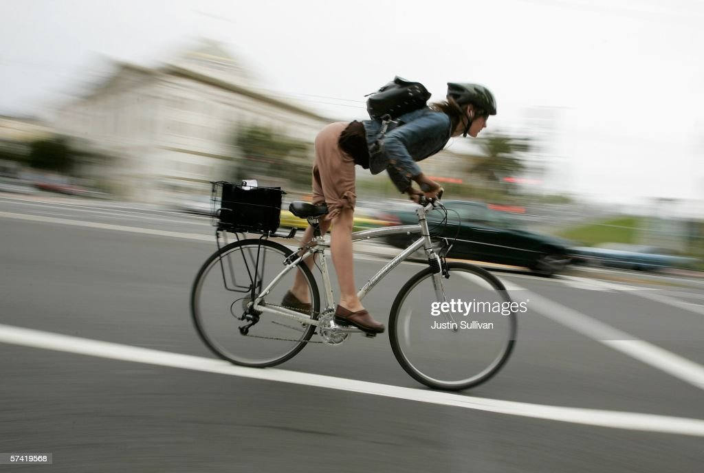 A bicyclist commutes along Market Street April 25 2006 in San Francisco California Many commuters are turning to alternative transportation like...