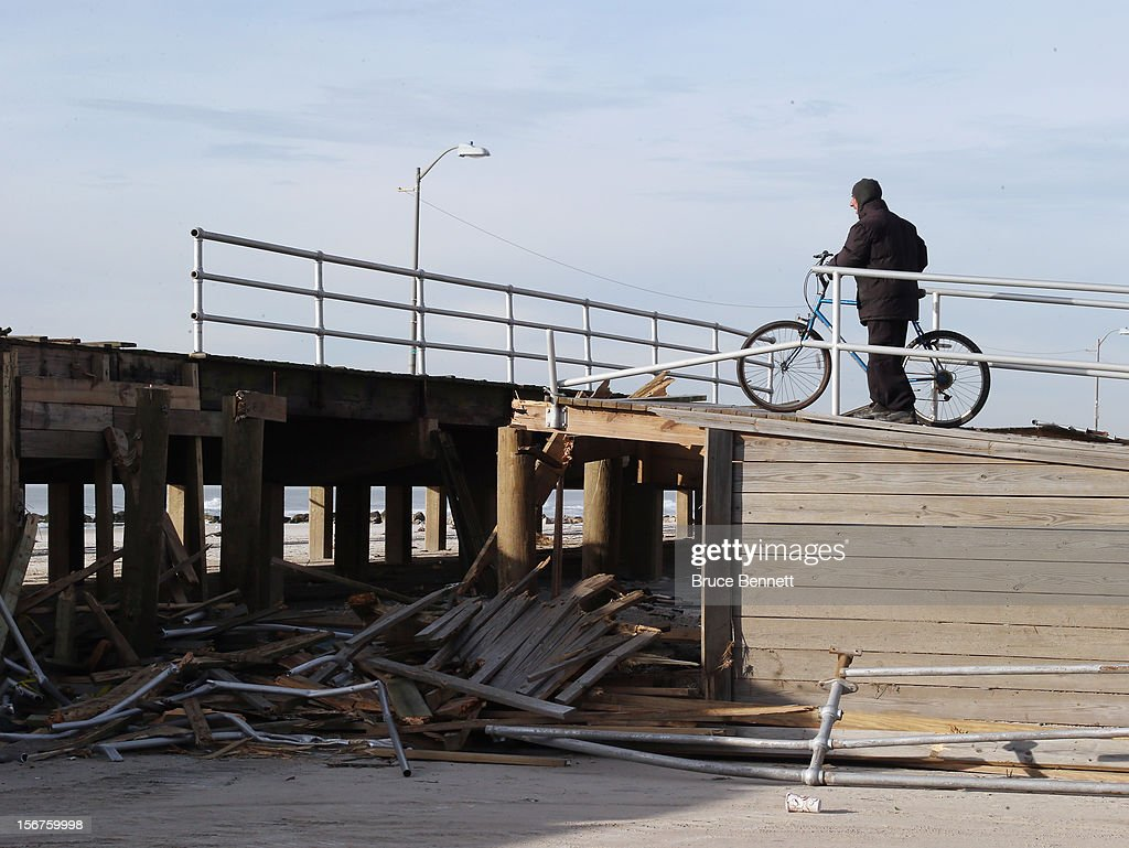 A bicyclist is stopped from entering the boardwalk because of storm damage on November 20, 2012 in Long Beach, New York. More than three weeks after Superstorm Sandy hit the New York area, residents continue their restoration efforts in many affected areas on Long Island.