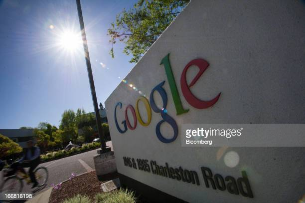 A bicyclist passes in front of Google Inc signage displayed outside of the company's headquarters in Mountain View California US on Tuesday April 16...