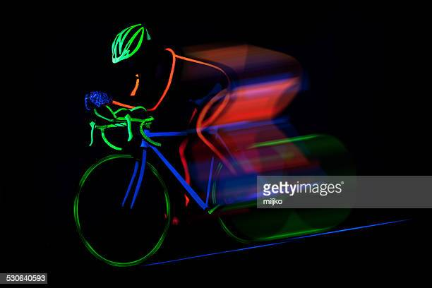 Bicyclist ride bike colored with fluorescent color