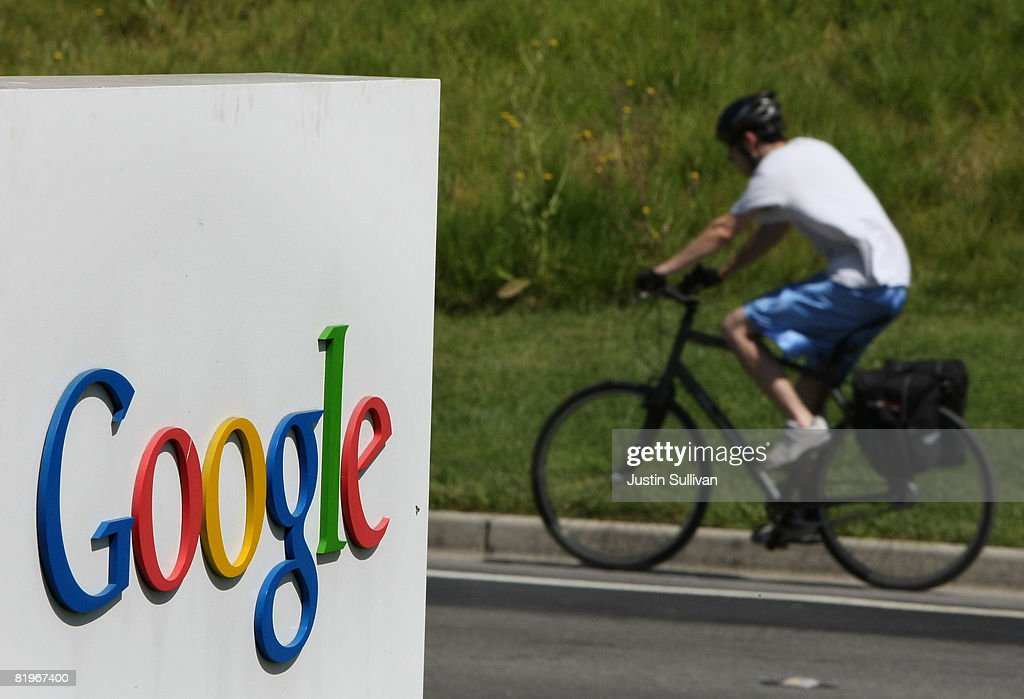A bicyclist rides by a sign outside of the Google headquarters July 17, 2008 in Mountain View, California. Google Inc. is expected to announce an increase in quarterly profits when it reports its quarterly earnings today after the closing bell.