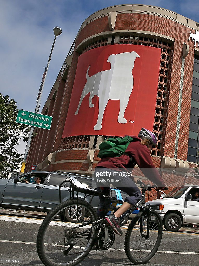 A bicyclist rides by the Zynga headquarters on July 25, 2013 in San Francisco, California. Online game maker Zynga will report second quarter earnings after the market close.